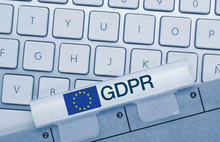 GDPR Compliance Written on Blue Key of Metallic Keyboard. Finger pressing key. 免版税图像