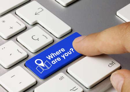 Where are you? Written on Blue Key of Metallic Keyboard. Finger pressing key.