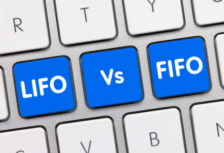 LIFO Vs. FIFO Written on Blue Key of Metallic Keyboard. Finger pressing key.