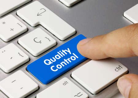 Quality Control Written on Blue Key of Metallic Keyboard. Finger pressing key. Banco de Imagens