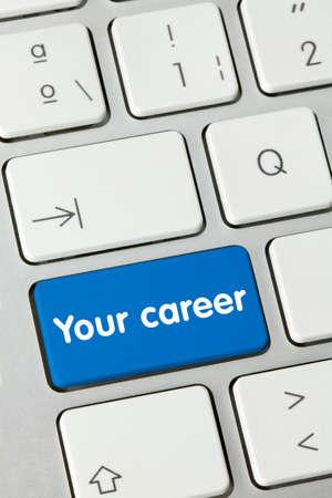 Your career Written on Blue Key of Metallic Keyboard. Finger pressing key.