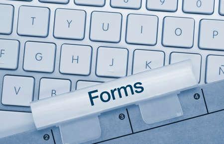 Forms Written on Blue Key of Metallic Keyboard. Finger pressing key.
