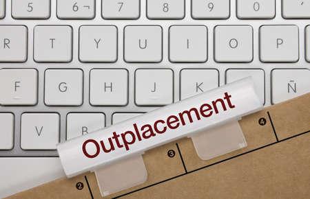 Outplacement Written on Wite Key of Metallic Keyboard. Finger pressing key. Imagens