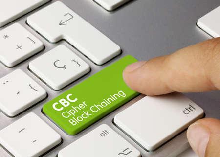 CBC Cipher Block Chaining Written on Green Key of Metallic Keyboard. Finger pressing key.