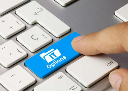 IT Options Written on Blue Key of Metallic Keyboard. Finger pressing key.