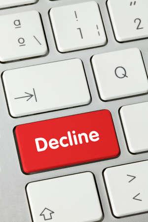 Decline Written on Red Key of Metallic Keyboard. Finger pressing key.