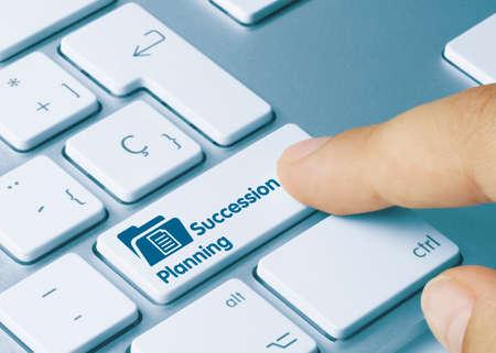 Succession Planning Written on Blue Key of Metallic Keyboard. Finger pressing key.