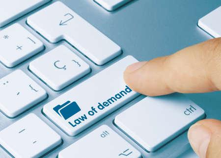 Law of demand Written on Blue Key of Metallic Keyboard. Finger pressing key. Stok Fotoğraf