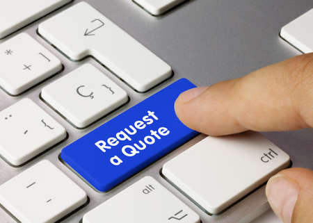 Request a Quote Written on Blue Key of Metallic Keyboard. Finger pressing key. Stok Fotoğraf