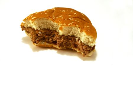 Remains of a partially eaten cooked burger