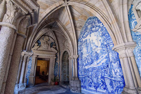 Cloister decorated with Azulejo mural in Porto Cathedral, a Catholic church in Porto, Portugal