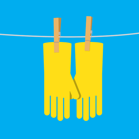 rubber yellow glove hang on the rope.
