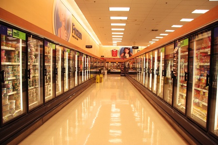 refrigerator with food: two ice box lines in supermarket of US city, normal life Editorial