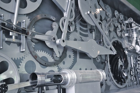 Big mechanical components shown on the wall photo
