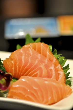 One plate of fresh sashimi in a japanese restaurant. photo