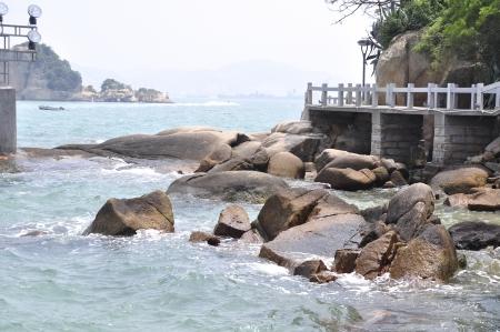 xiamen landscape with sea, rocks and beach photo