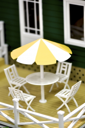 mini bar with yellow sunshade and white chairs