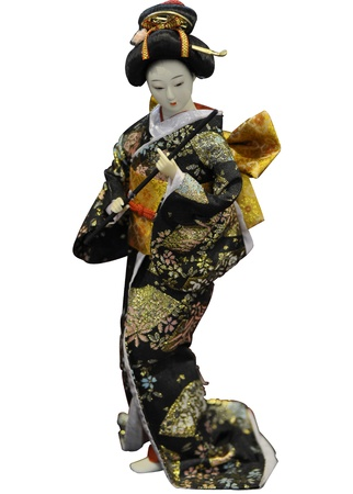 Japanese geisha toy isolated on white background photo