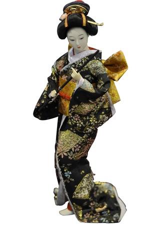 Japanese geisha toy isolated on white background photo