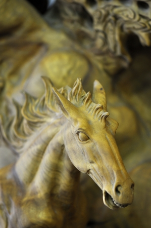 carved wooden horse portrait in a strong whinny action photo