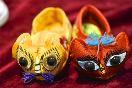 Chinese traditional colorful cloth shoes for kid in a row