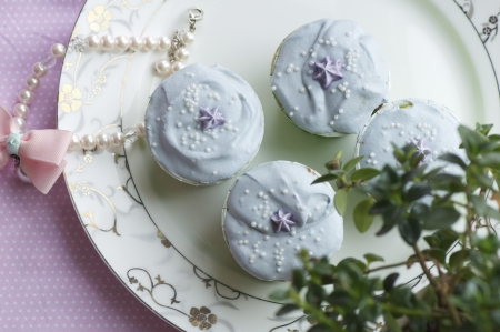 handmade colorful cup cakes shot in a closeup scene