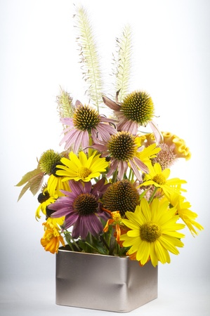 close up shot of autumn bouquet with various blooming flowers photo