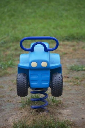 single blue toy car on the ground for kid,  photo