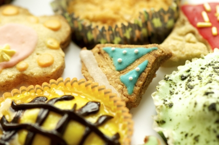 Group of handmade cupcakes and biscuits shot close-up