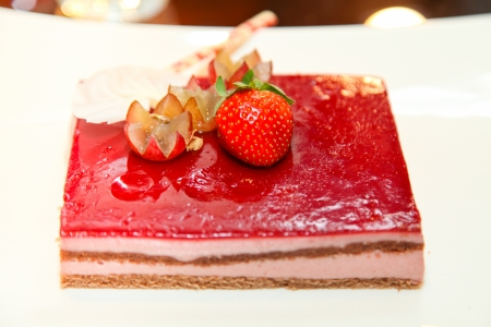 fresh red wedding cake, made by strawberry and grape