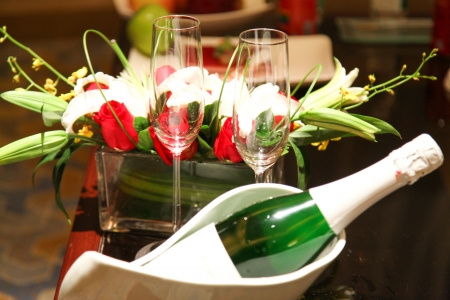wedding champagne with glass and bouquet in studio shoot