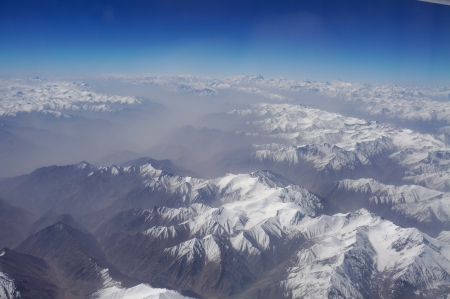 aerial view of Karakoram mountains of Sinkiang, China, you can see frozen peaks and deep valley   Stock Photo