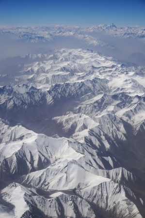 bird 's eye view: aerial view of Karakoram mountains of Sinkiang, China, you can see frozen peaks and deep valley   Stock Photo