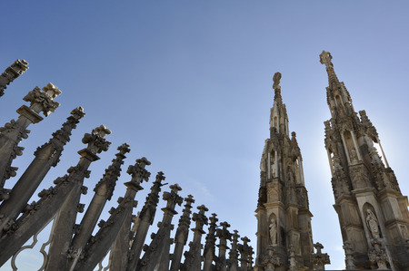 Different Gothic style statues of milano Duomo, one of the biggest Gothic style church in the world. Stock Photo