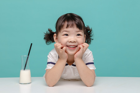 Little pretty Asian girl laughing portrait with milk, healthy and happy lifestyle. Stock Photo - 111833350