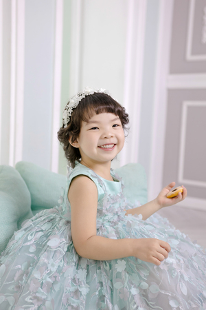 Little pretty Asian girl dressing as princess laughing portrait, healthy and happy lifestyle.