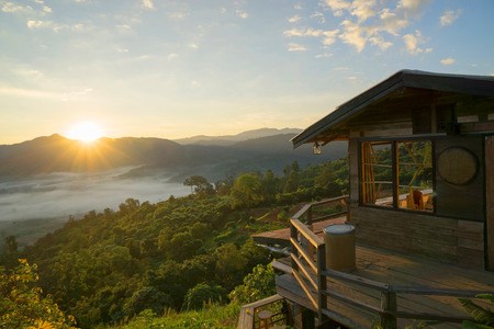 Wooden house on the top of the mountain in thailand