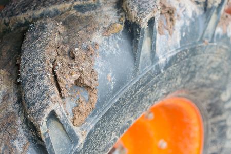 crampon: Close up mud on tractor wheel Stock Photo
