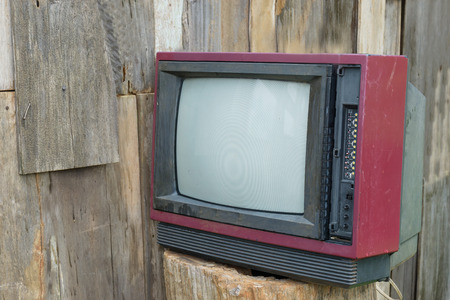 old vintage television on wood trunk