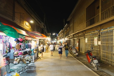 LOEI - THAILAND - JUNE 10 2017 - Night market in the chaing khan distinct. The people walk and buy identity souvenir in this place.