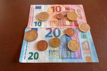 banknotes and coins of European currency Euro, Eur 10 20