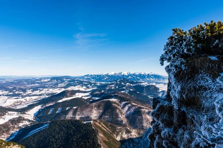 High Tatras mountains snowy in winter with beautiful hills below them, Slovakia Velky Choc 12.1.2020 Stock Photo