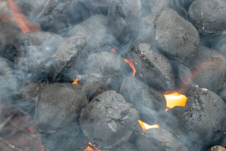 BBQ Grill Pit With Glowing And Flaming Hot Charcoal Briquettes, Food Background Or Texture, Close-Up. Stock Photo