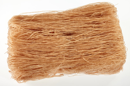 brown white: Brown rice vermicelli isolated on white background Stock Photo