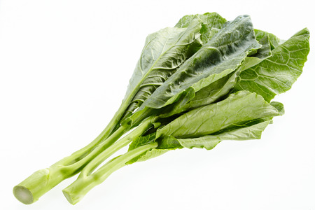 greens: Collard or chinese kale isolated on white background.