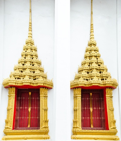 Thai Temple windows  are made of golden and it has great architecture in hindu and local traditional  This is gate of Grand hall  Church in Templ  In south east asia there are many famous temple with hindu architecture such as Lao,Mynmar,Cambodia,Thailand Stock Photo - 13662900