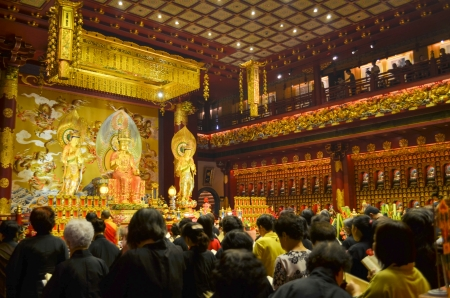 26 July 2013 : Buddhism Ritual  with Prayers at Buddha Tooth Relic, Temple Singapore. Many people are praying with faith in front of  Avalokitesvara statue