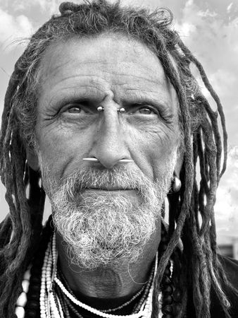 Eccentric gentleman with facial jewelry in black and white
