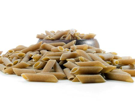 penne: Whole wheat penne pasta isolated on white