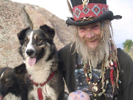 An eccentric older gentleman with his dog photo